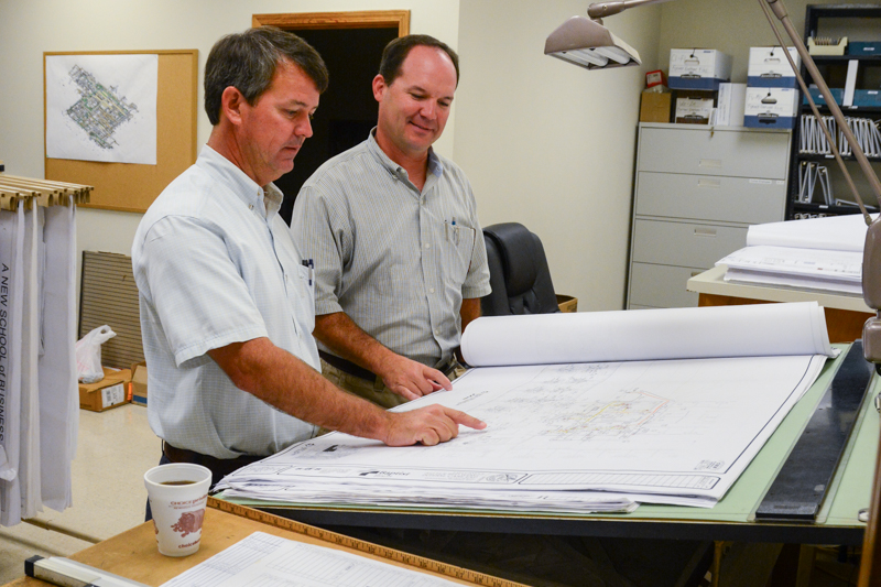 Bradley Plumbing and heating staff reviewing job plans