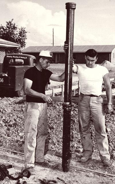 historic photo of Bradley Plumbing and Heating workers